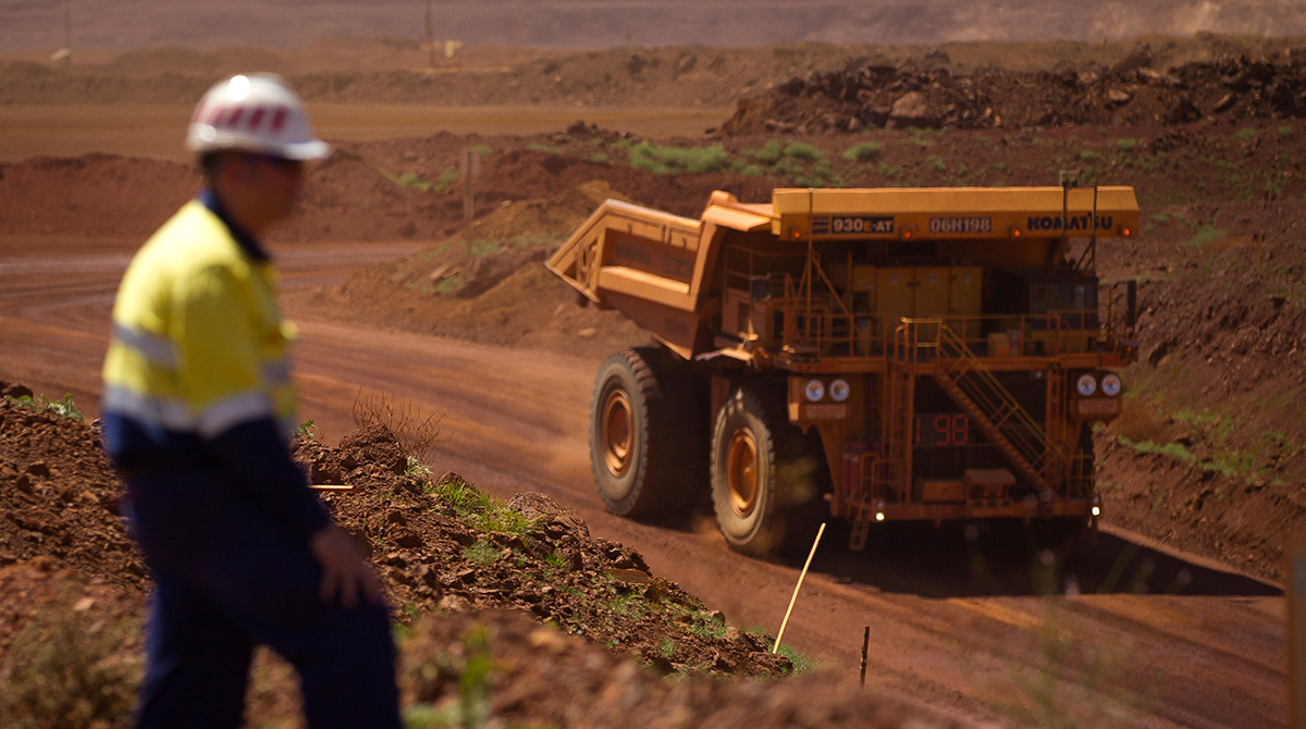 Nick Courtois, project manager of autonomous haulage systems at Rio Tinto Group, watches as an autonomous haul truck drives through a pit at the company's West Angelas iron ore mine in Pilbara, Australia.