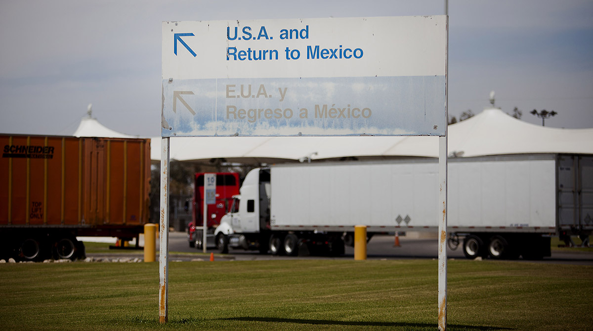 Border-crossing trucks and sign
