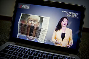 An online video about U.S.-China trade tensions plays on a computer screen in Beijing.