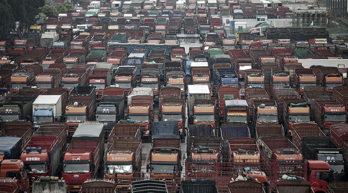 Trucks sit idle in a parking lot at a logistics park in Chengdu, China.