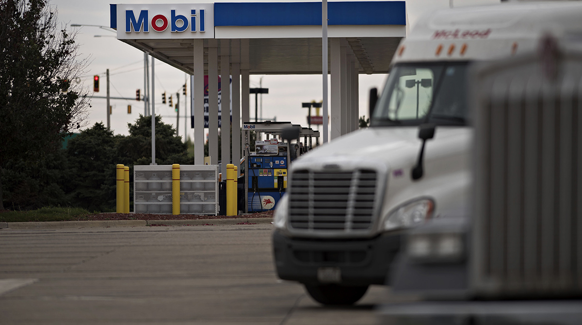 Trucks sit in a parking lot outside a Mobil gas station in Morton, Ill.