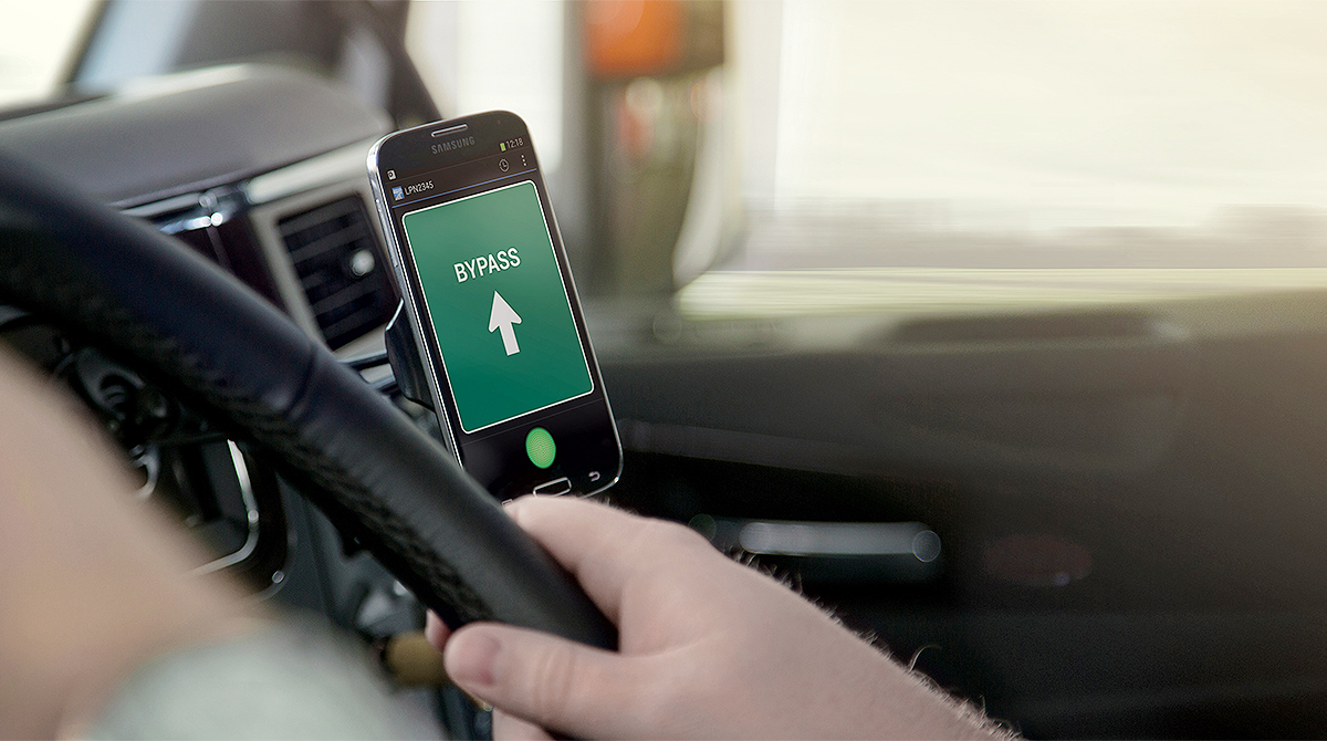 Driver Uses Drivewyze via smartphone