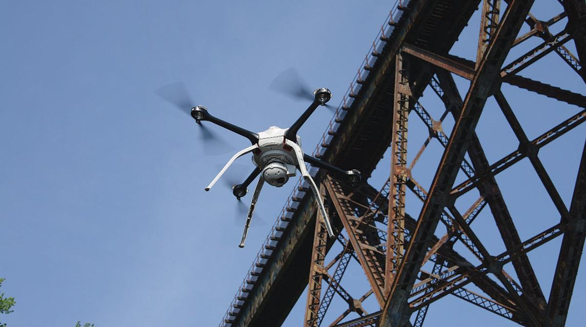 A drone inspects a bridge
