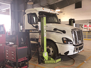 Truck in Ryder shop shown with ARI-Hetra mobile lifts