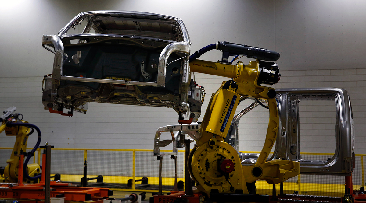 A robot moves a Ford Motor Co. F150 truck on the production line at the company's Dearborn Truck Assembly facility in Dearborn, Mich.