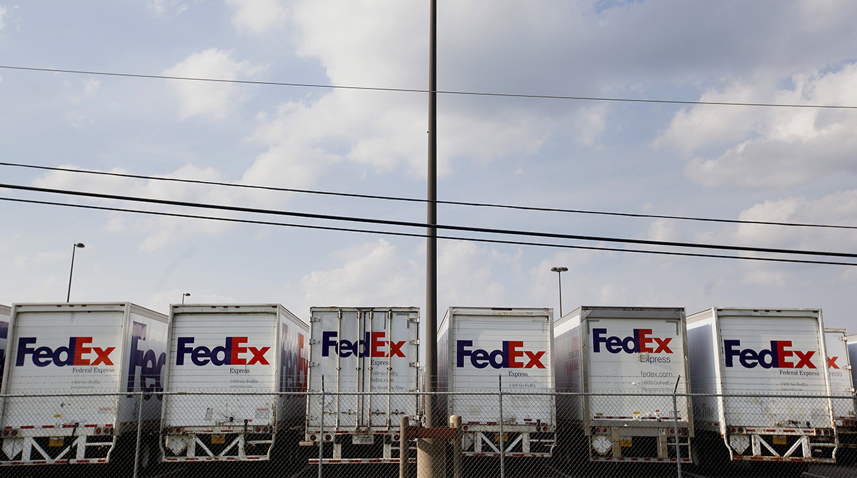 FedEx Corp. trucks sit lined up in a parking lot of the company's ship center near the Memphis International Airport in Memphis, Tenn.
