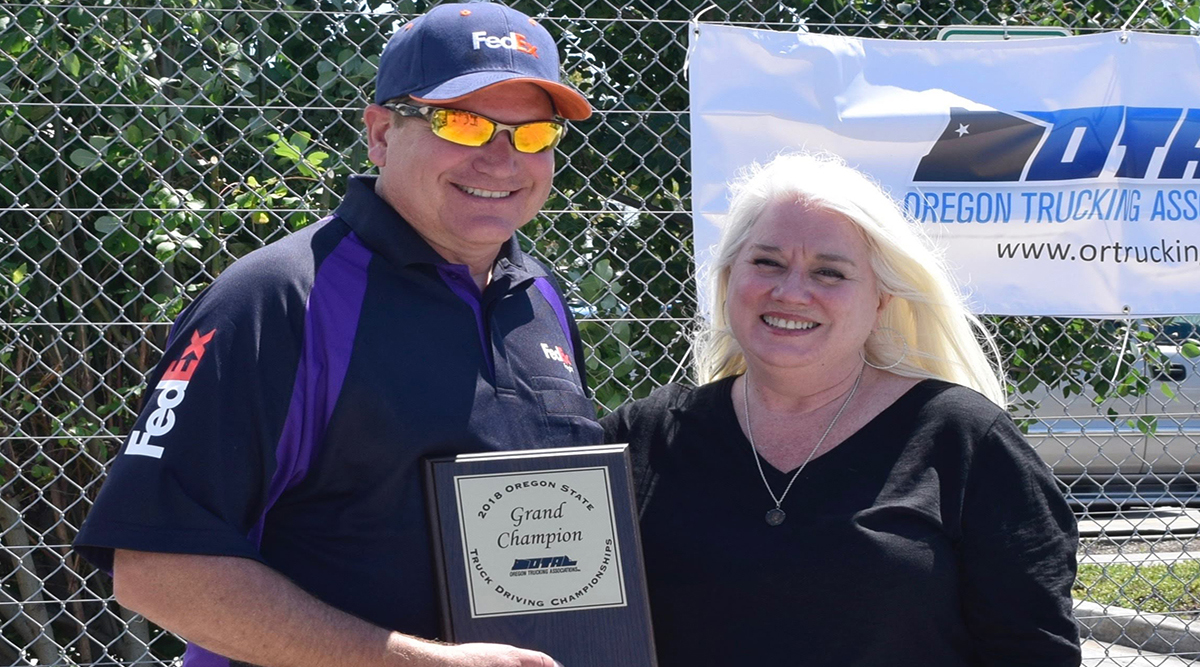 2018 Oregon Truck Driving Championships Grand Champion Chris Outen with Oregon Trucking Associations President Jana Jarvis