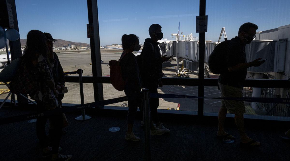 Travelers board a flight in San Francisco on Oct. 15.