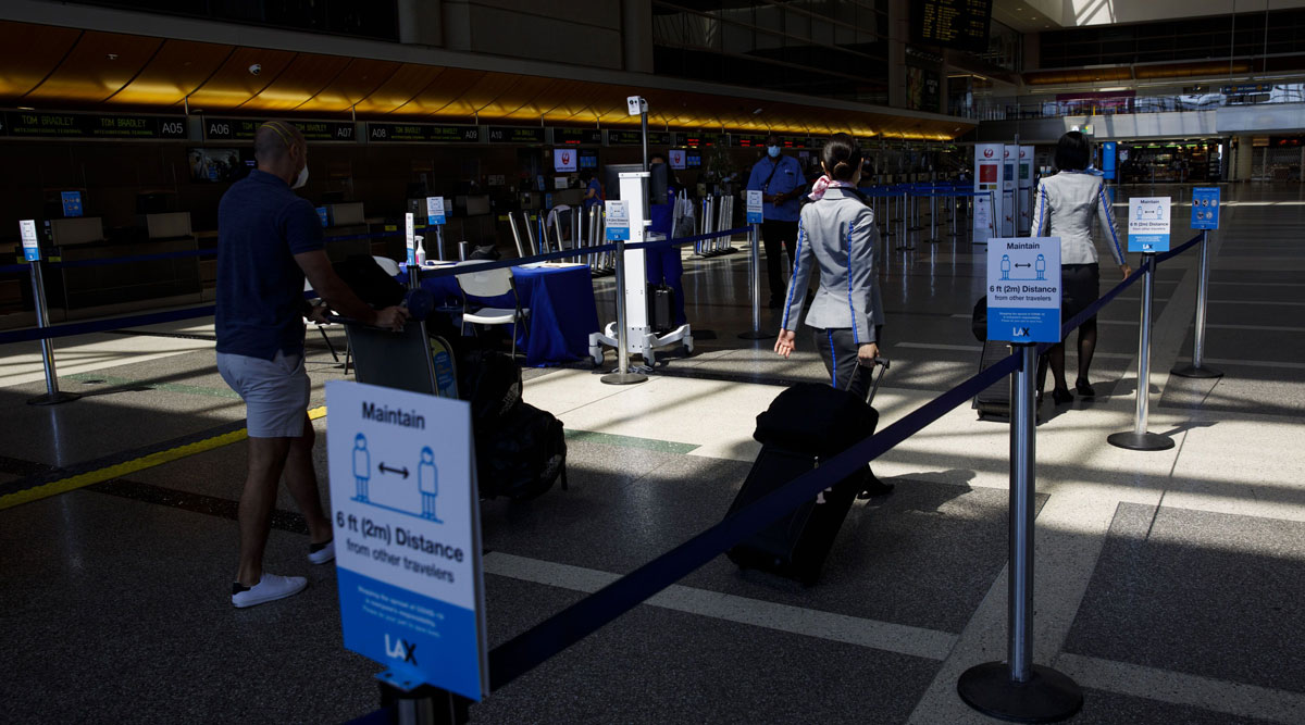 Passengers walk past thermal imaging cameras at LAX on July 7.