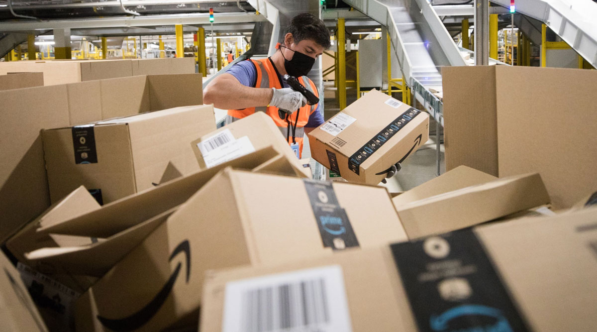 An employee scans a package at an Amazon fulfillment center in the U.K.