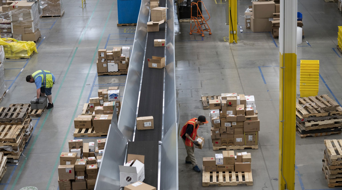 Employees work inside an Amazon fulfillment center in Baltimore in April 2019.