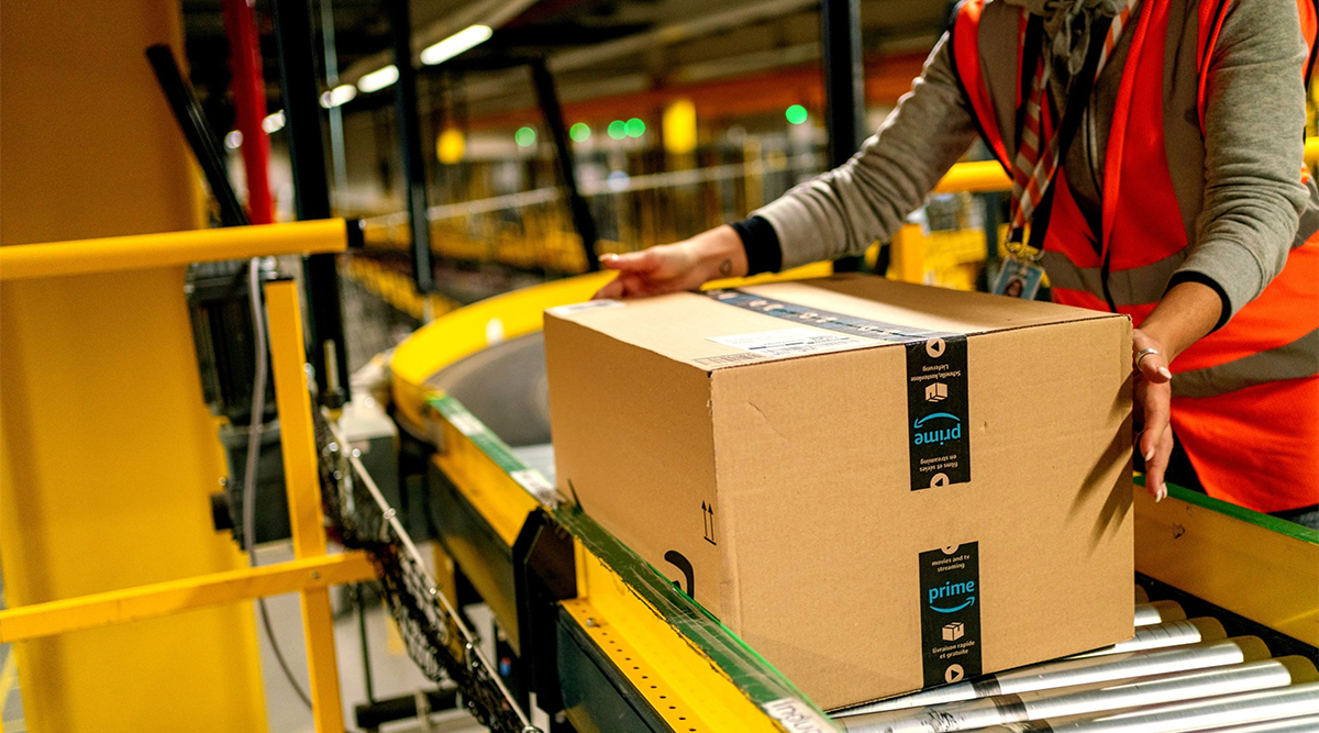 An Amazon Prime warehouse worker collects a package. (Thorsten Wagner/Bloomberg News)