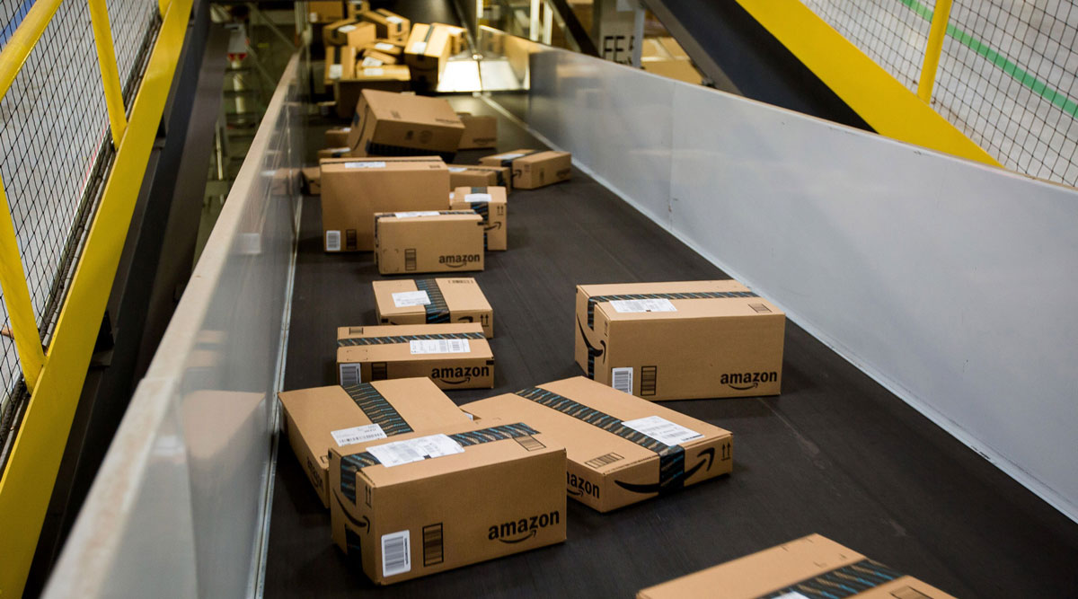 Boxes move along a conveyor belt at an Amazon fulfillment center in New Jersey.