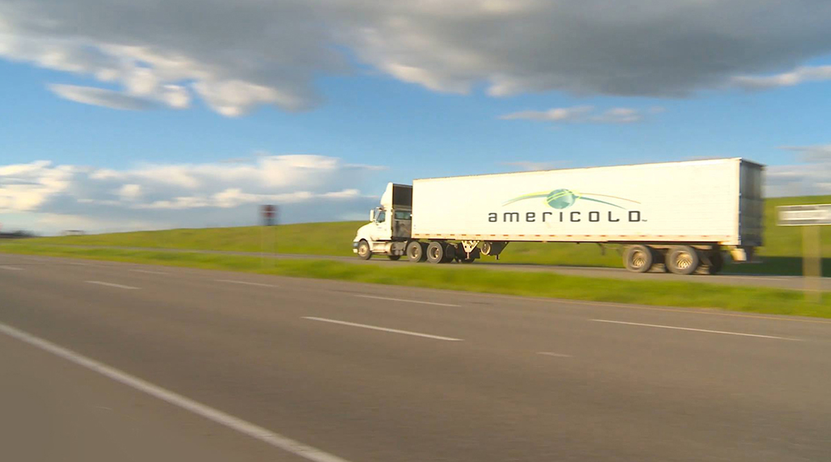 Americold truck driving on highway