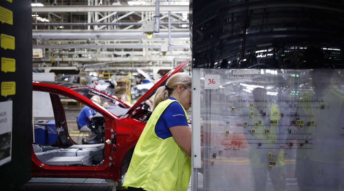 A worker views an implementation map at a Toyota manufacturing plant in Kentucky in August 2019.