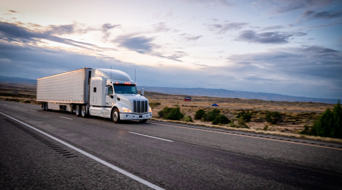 Auto regulators say they will move to require or set standards for automatic braking systems on heavy trucks.