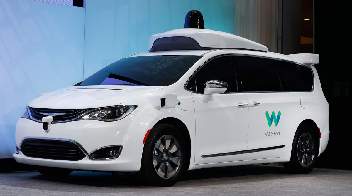 A Chrysler Pacifica hybrid outfitted with Waymo technology is displayed at an auto show in Detroit in January 2017.