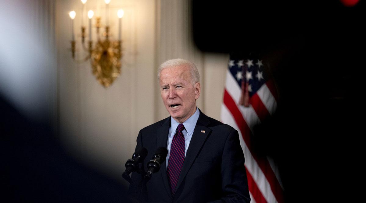 President Joe Biden speaks in the State Dining Room of the White House on Feb. 5. (Stefani Reynolds/Bloomberg News)