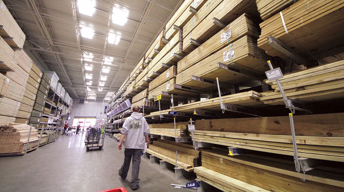 A customer shops for lumber