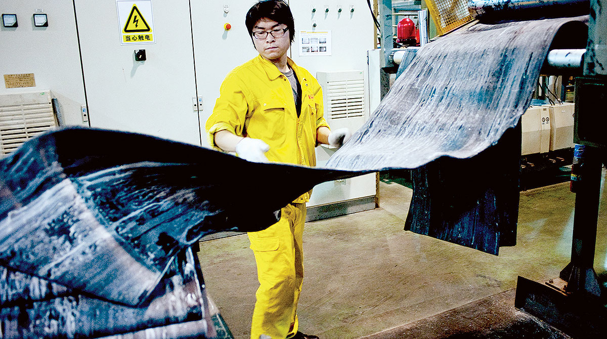 Worker in Chinese tire factory