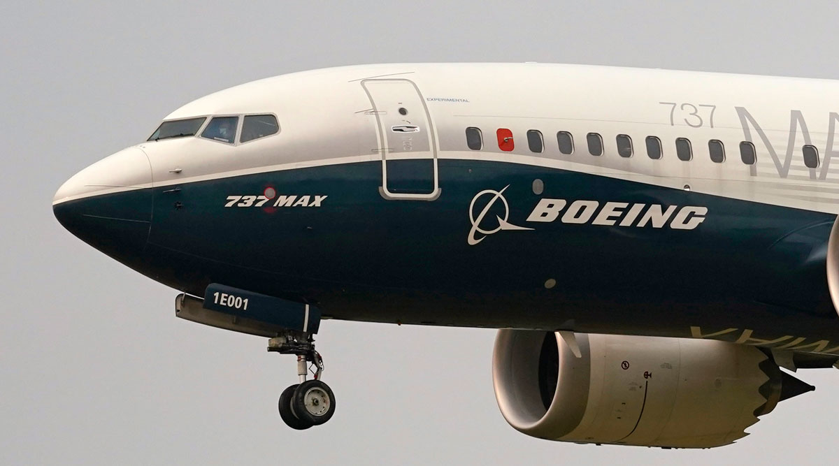 A Boeing 737 Max jet, piloted by FAA Chief Steve Dickson, prepares to land during a test flight.