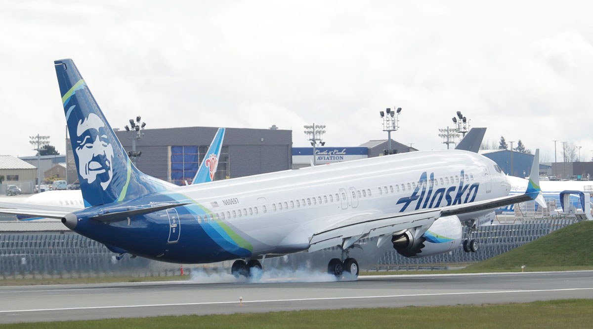 An Alaska Airlines Boeing 737-9 Max lands in Everett, Wash., on March 23.
