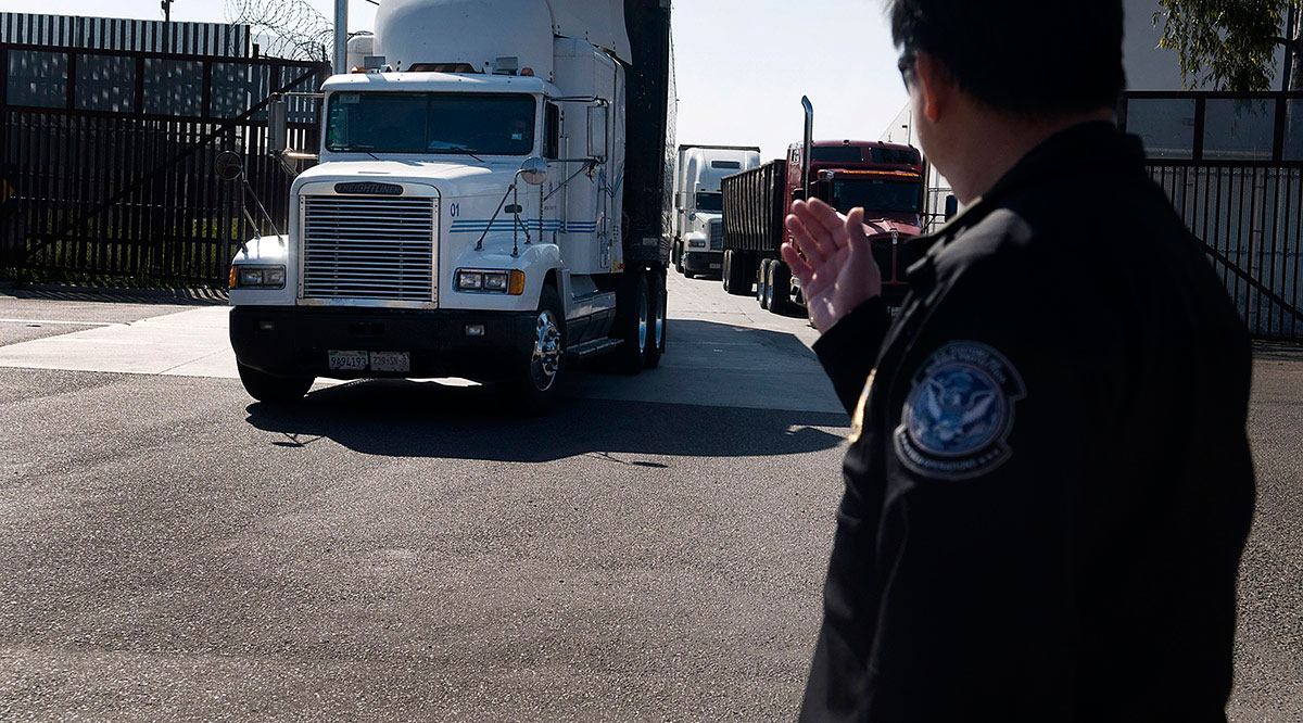 Trucks cross the U.S.-Mexico border at Otay Mesa.