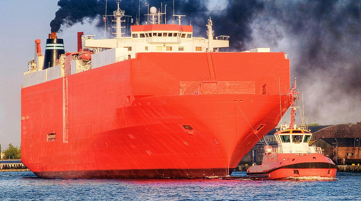 Cargo ship spewing black smoke