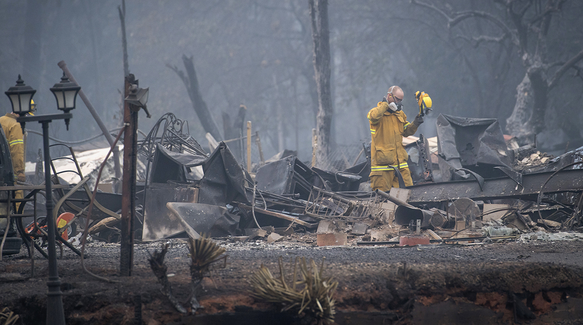 Firefighters in what is left of Paradise, Calif.