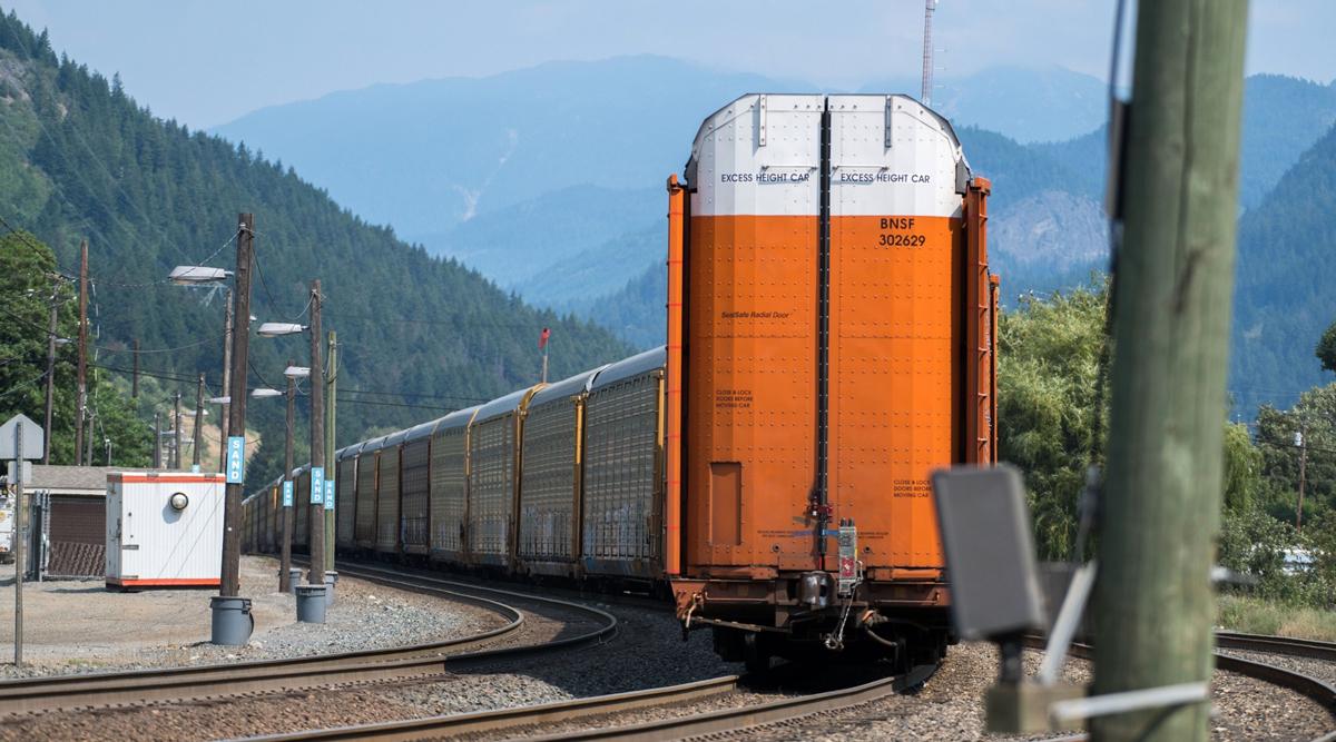 Rail cars sit as wildfires burn near Lytton, British Columbia, on July 2. (James MacDonald/Bloomberg News)