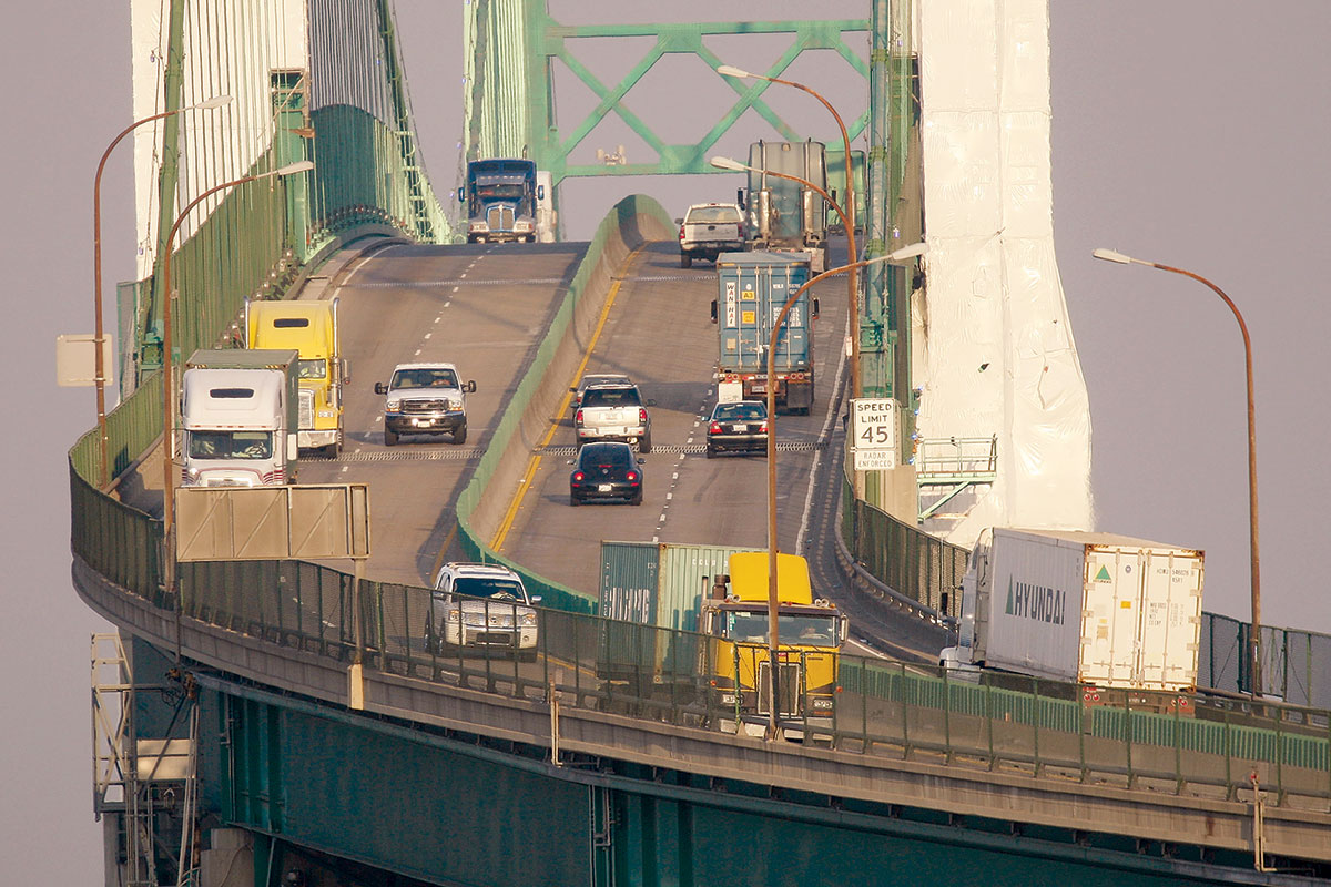 Trucks cross the Vincent Thomas Bridge at the Ports of Long Beach and Los Angeles.