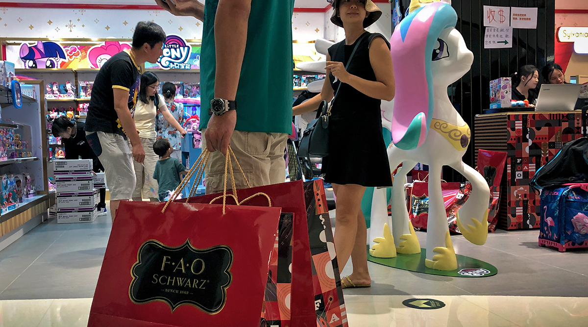 People shop at an FAO Schwarz toy store in Beijing.