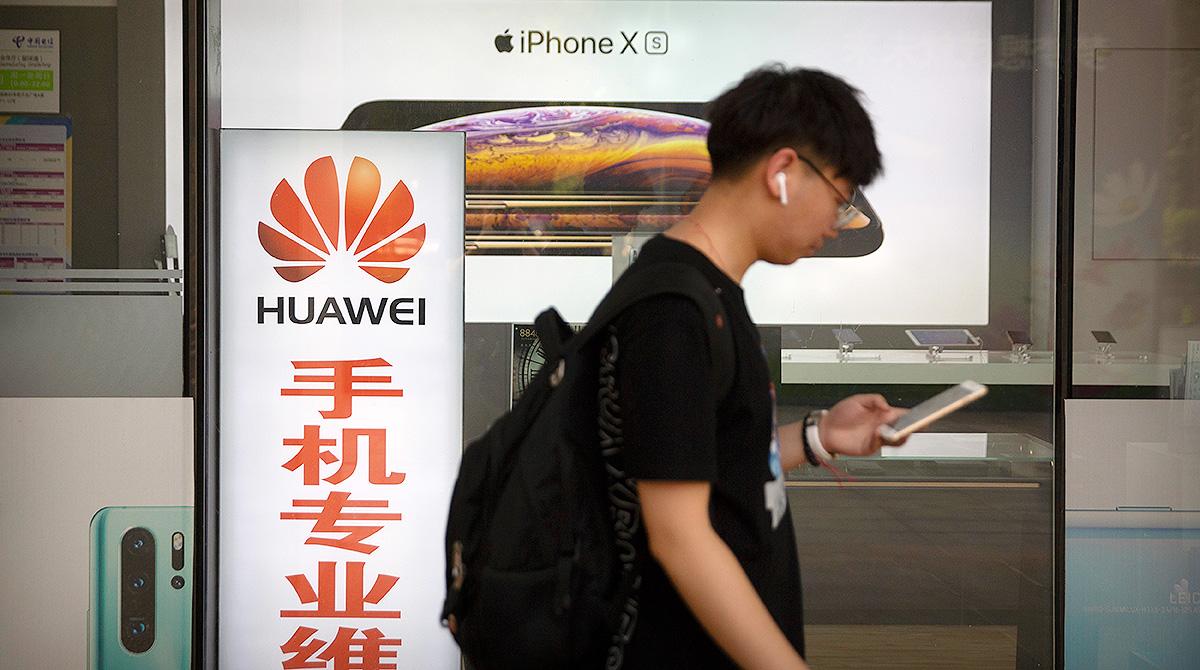 Man passing electronics store in Beijing