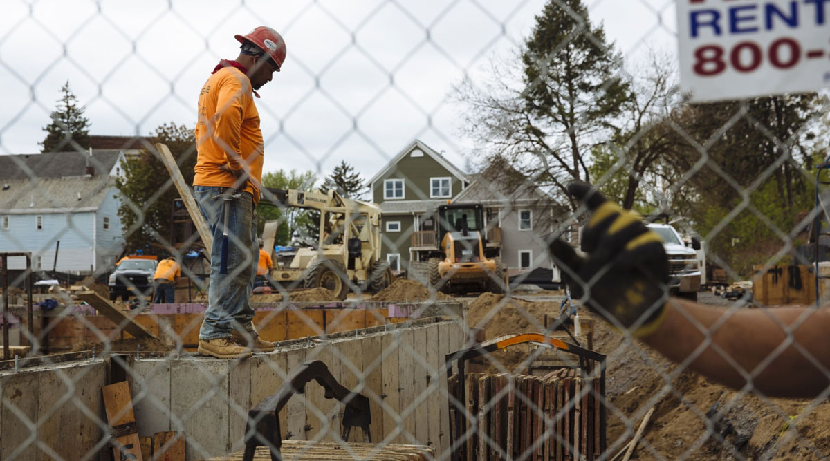 A worker stands at a housing construction site in New York on May 15.
