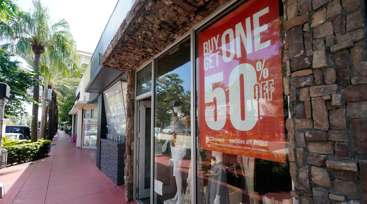 A business displays a sale sign in Surfside, Fla., on Oct. 12.