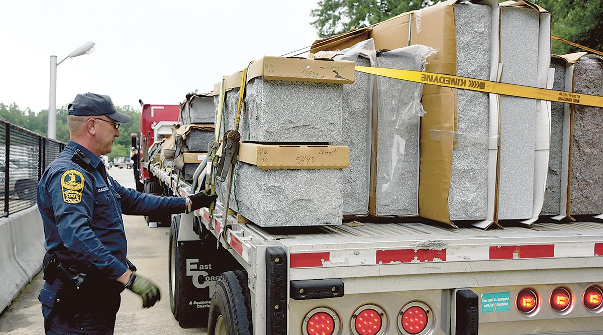 Officer checking cargo during CVSA Roadcheck
