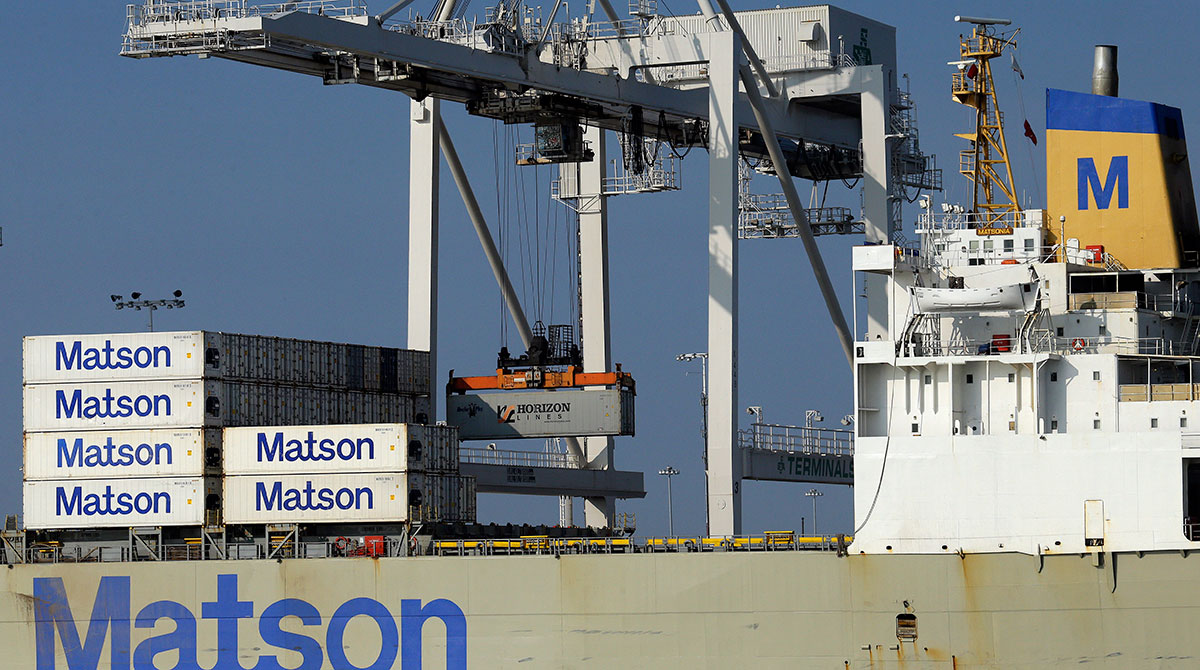 A container ship is unloaded at the Port of Oakland-trade deficit