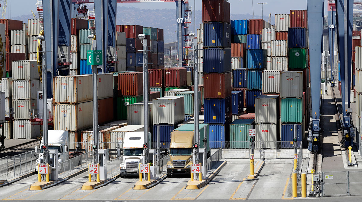 Cargo is unloaded from trucks at the Port of Long Beach.