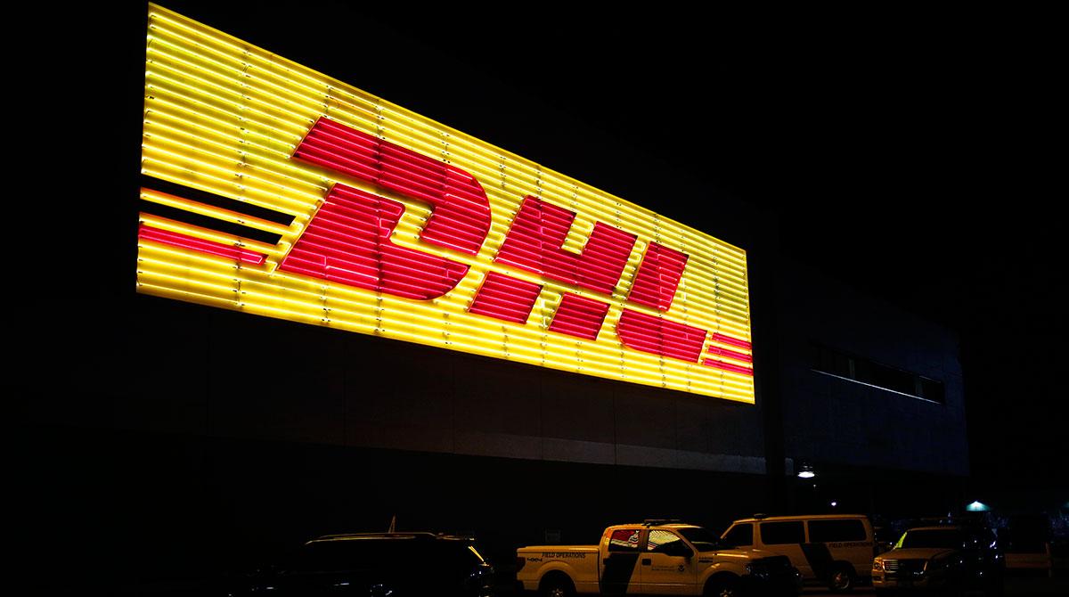 Neon DHL sign at night