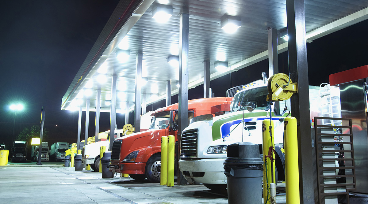Trucks refueling at night