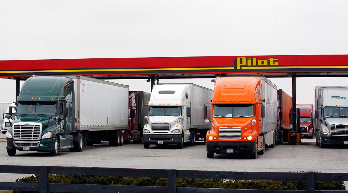 Trucks fueling up at a Pilot station