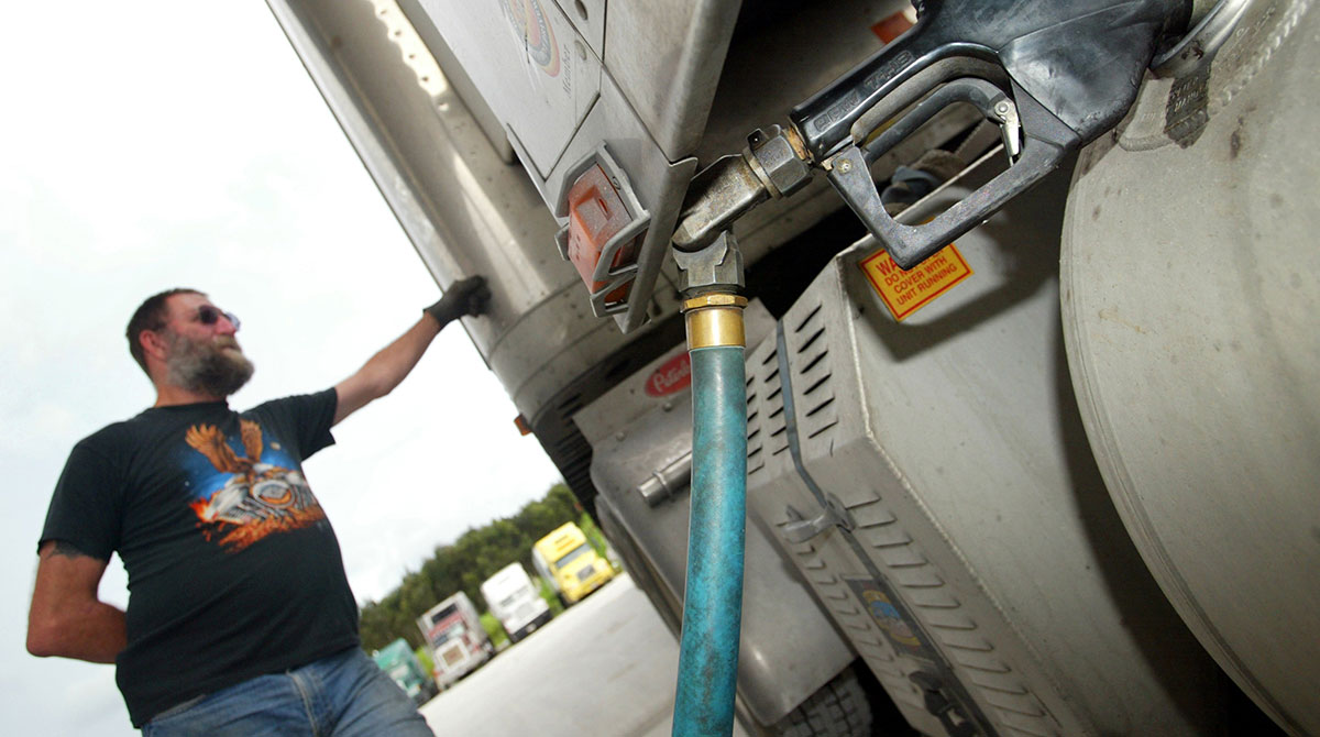 A driver fills his rig with diesel