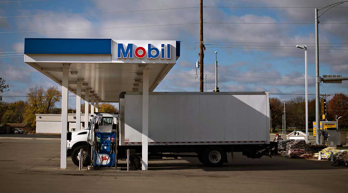 Truck fills up at Mobil gas station