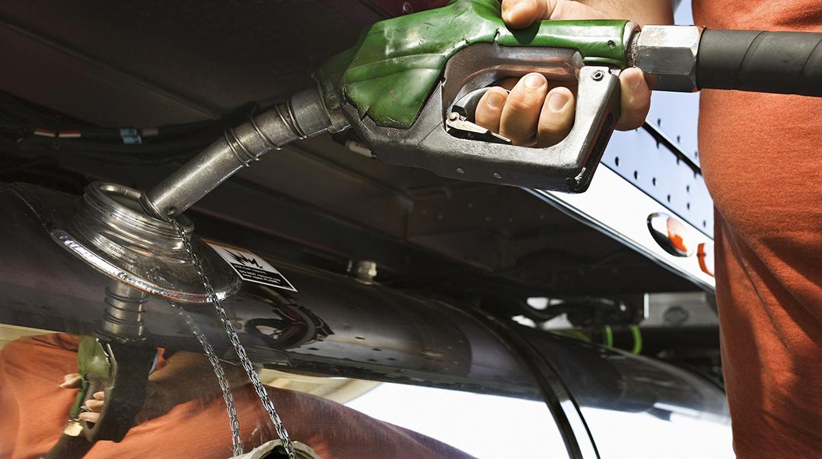 A driver fuels his rig