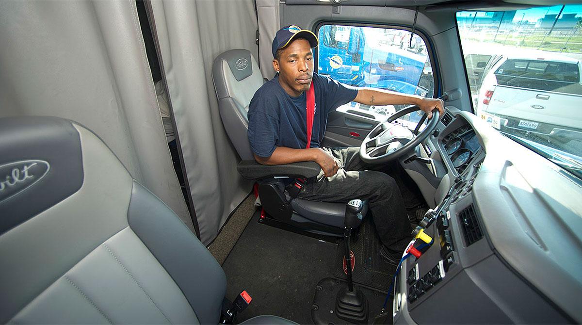 Driver in cab interior
