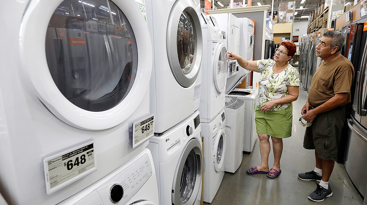 shoppers look at washer-dryers
