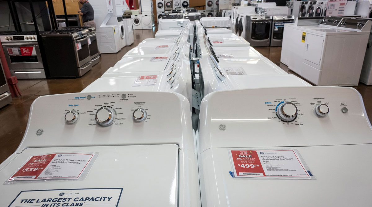 GE washing machines are displayed at a home appliance store in California.