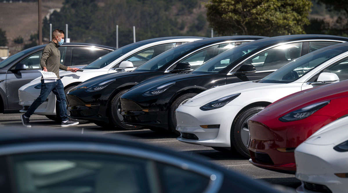 Tesla vehicles sit in a lot at a Tesla store in Colma, Calif., on Sept. 24.