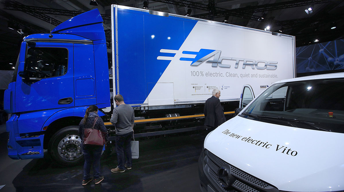 A Mercedes-Benz eActros electric cargo truck, left, and a Mercedes-Benz Vito electric van
