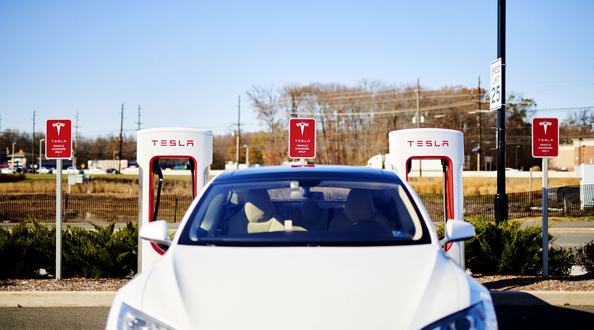 A Tesla vehicle sits parked in front of a charging station in New Jersey in November 2019.